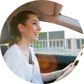 Picture of woman smiling while driving a car